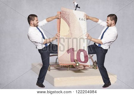 Two Businessmen Fighting Over Money