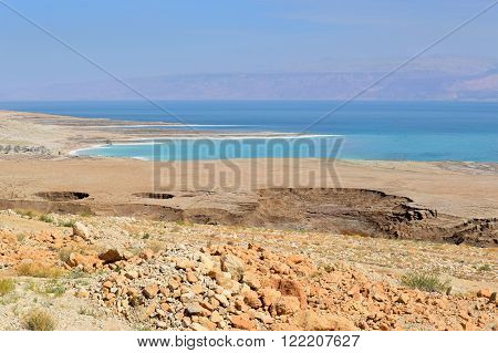 landscape of the Dead Sea, failures of the soil and the strong shallowing of the sea, illustrating an environmental catastrophe on the Dead Sea, Israel