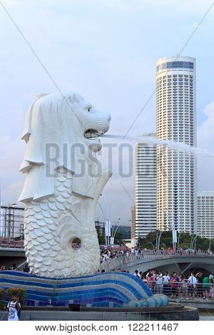 Singapore, Singapore - May 17, 2015: The Merlion statue at the Marina bay with the Skyline in the background. The Merlion is a traditional creature in Singapore with a lions head and a body of fish.