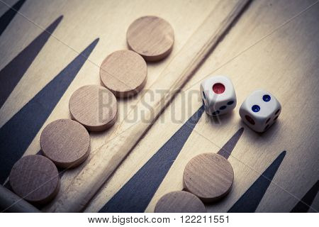 Color image of a backgammon board with dice.