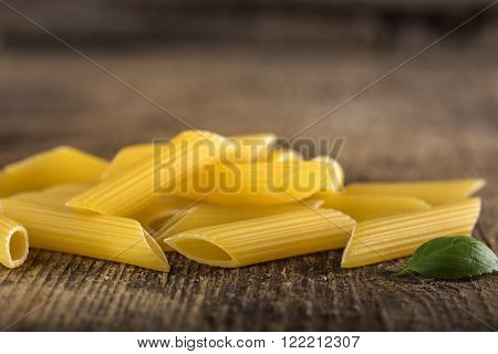 Pasta Penne Rigate on a wooden background
