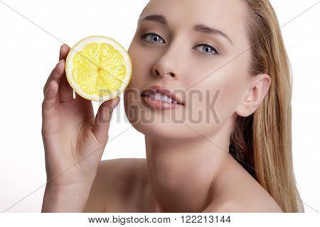 Young Happy Woman Showing A Fresh Lemon