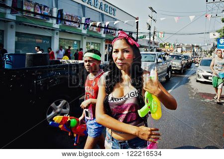 KO SAMUI, THAILAND - APRIL 13: Unidentified girl in a water fight festival or Songkran Festival (Thai New Year) on April 13, 2014 in Chaweng Main Road, Ko Samui island, Thailand.
