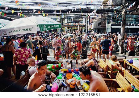 KO SAMUI, THAILAND - APRIL 13: ?rowd of unidentified people at the celebration of the water fight festival or Songkran Festival (Thai New Year) on April 13, 2014 in Chaweng Main Road, Ko Samui island, Thailand.