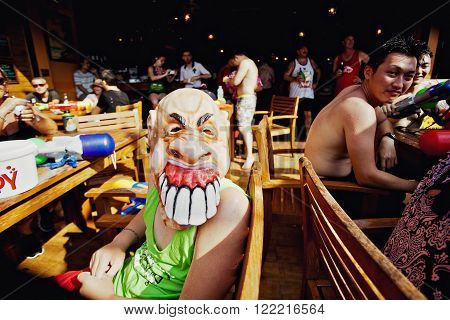 KO SAMUI, THAILAND - APRIL 13: Unidentified man in a terrible mask in a water fight festival or Songkran Festival (Thai New Year) on April 13, 2014 in Chaweng Main Road, Ko Samui island, Thailand.