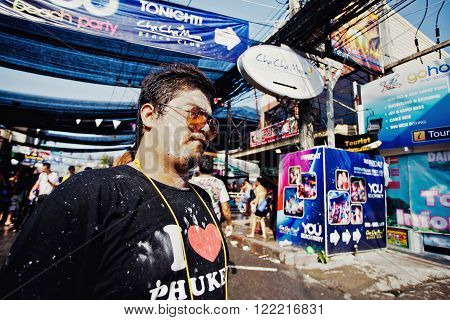 KO SAMUI, THAILAND - APRIL 13: Unidentified smeared man in a water fight festival or Songkran Festival (Thai New Year) on April 13, 2014 in Chaweng Main Road, Ko Samui island, Thailand.