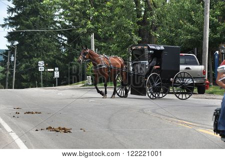 Holmes County,Ohio,USA - August 11, 2013 : The Amish Buggy down a country road in Holmes County