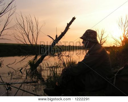 The Fisher On Evening Lake