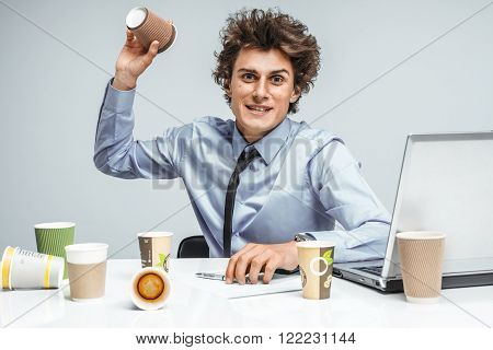Mad tired manager / modern businessman at the workplace working with computer depression and crisis concept