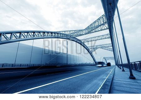 Chinese modern building bridges and high-speed car, blue tone picture