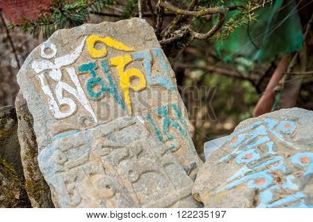 Mani stones with mantras in Namche Bazaar, Nepal.