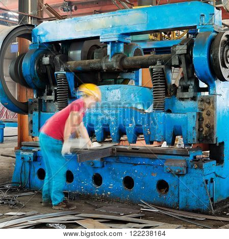 Steel metal cutting factory workers in the shop machinery and equipment