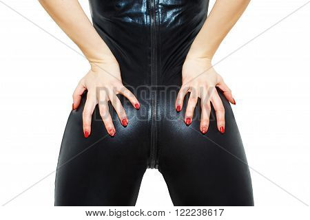 Sexy woman ass in latex catsuit with red nails, bdsm, isolated on white