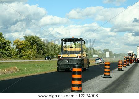 Road rollers with tracked paver machine during road construction ** Note: Visible grain at 100%, best at smaller sizes
