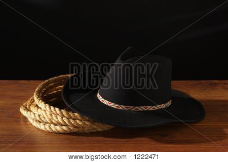 American West Rodeo Cowboy Hat and Ranching Rope