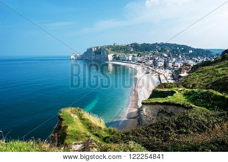 View from the famous white cliffs of Etretat on the beach and the village, Alabaster Coast, Normandy, France