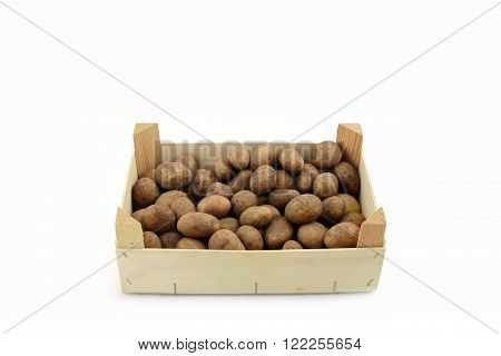 wooden box with potatoes on a white background