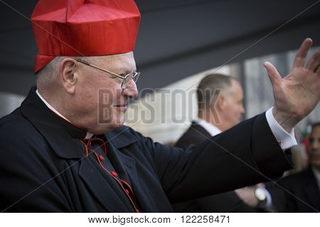 NEW YORK - MARCH 17, 2016: Timothy Cardinal Dolan Archbishop of New York waves to parade marchers in front of St Patricks Cathedral on Saint Patricks Day in Manhattan on March 17, 2016.