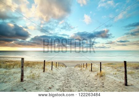 sand way to the North sea beach and beautiful sky Holland