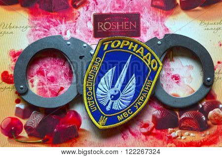ILLUSTRATIVE EDITORIAL.Chevron of Ukrainian nazionalist battalion Tornado in Police.The battalion disbanded for looting,rape and torture. With logo Roshen Inc. .At February 20,2016 in Kiev, Ukraine