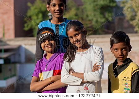 JODHPUR, INDIA - JAN 28: Unidentified happy children possing together on the indian street on January 28, 2015 in Rajasthan. Rajasthan has a literacy rate of 67.06 perc. and population of 70000000