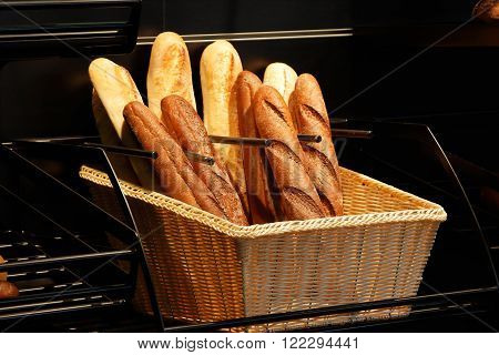 Some fresh baguettes in the basket at the bakery. Shallow focus.