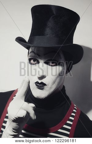 Portrait of mad hatter dressed in black hat on white background