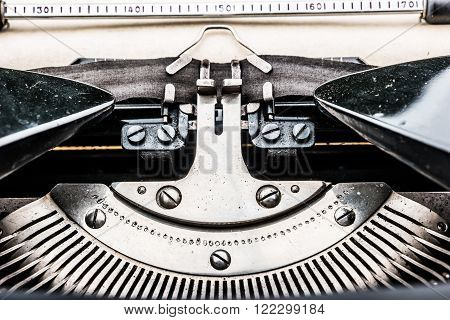 Old typewriter on table. Closeup photo of a vintage typewriter.