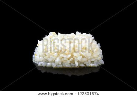 A pile of wet rice on a black background