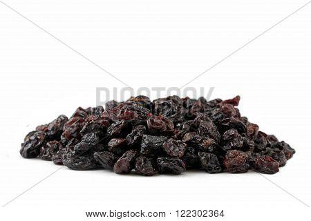 A pile raisins on a white background