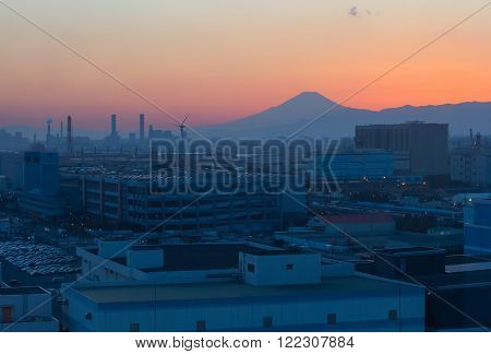 Mountain Fuji and Japan industry zone from Kawasaki city at twilight time