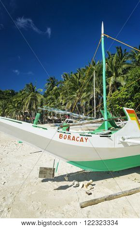 traditional fishing boat on puka beach in tropical paradise boracay philippines