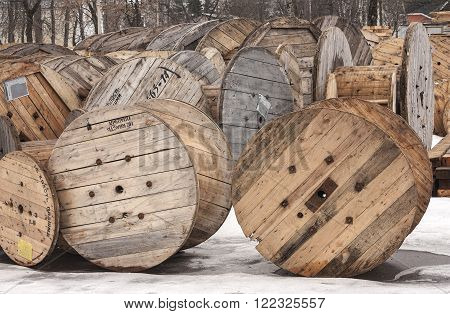 wooden cable reels in stock in the open air