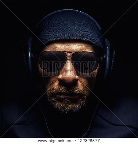 Head Of A Man With Headphones