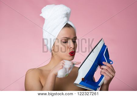 Beautiful Woman With A Iron