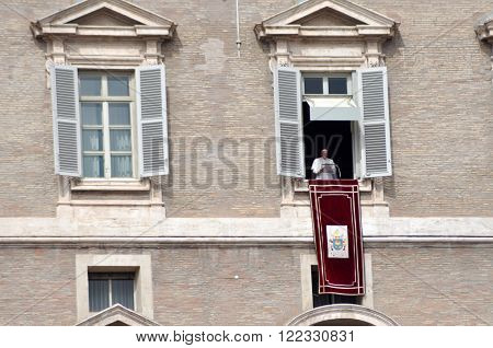 VATICAN - MARCH 13 2016: Pope Francis I born Jorge Mario Bergoglio holding the Angelus prayer and speech at the Vatican City