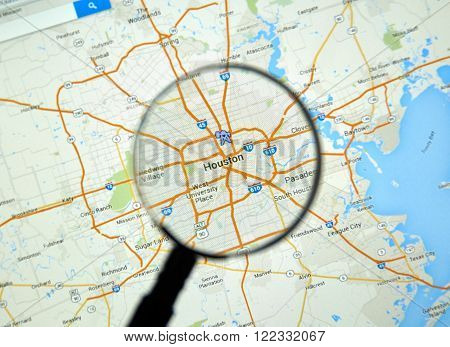 MONTREAL CANADA - MARCH 17 2016 - Houston on Google Maps app under magnifying glass.
