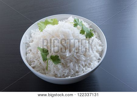indian basmati rice pakistani basmati rice asian basmati rice cooked basmati rice cooked white rice cooked plain rice in oval brass bowl over black background