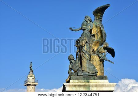 Bronze sculptoral group cast by artist Monteverde in 1911 with statues symbolizes: genius thought discord Minerva goddess and Italian people rising from tyranny. Trajan column in the background with St Peter statue. poster