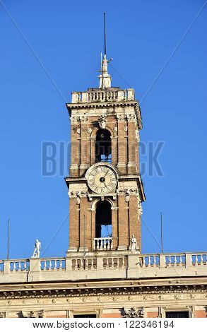 Reinassance Bell Tower at the top of Capitoline Hill in Rome designed by Martino Longhi in the 16th century with Minerva statue and papal coat of arms