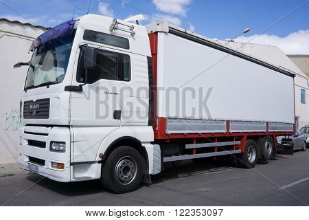 VALENCIA, SPAIN - MARCH 10, 2016: A MAN Truck on the streets of Valencia. MAN Truck and Bus company is headquartered in Munich, Germany and is a leading international provider of commercial vehicles.