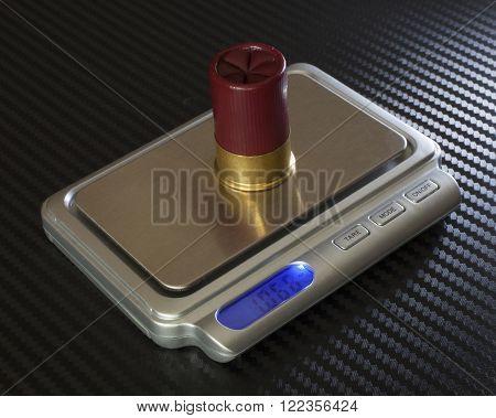 Short twelve gauge ammunition being measured on a digital scale