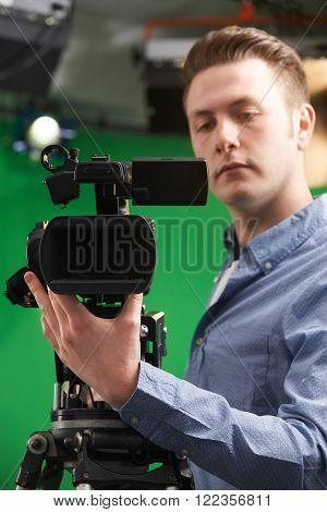 Male Camera Operator Working In Television Studio
