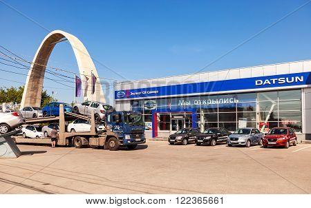 SAMARA RUSSIA - JULY 23 2015: Truck brought new cars to car showroom Datsun