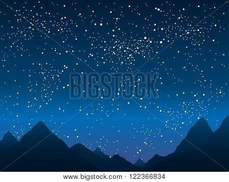 Silhouette of the mountains in the background of the starry sky.