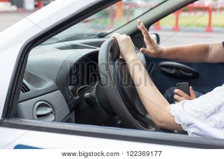 A learner driver driving car with instructor