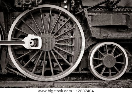 steam locomotive wheel detail in warm black and white