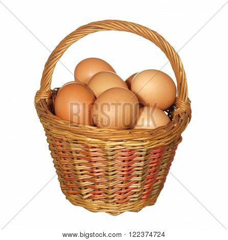 large wicker basket with chicken eggs isolated on white background.
