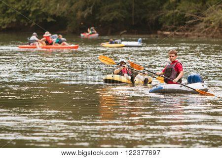 ATLANTA, GA - JULY 2015: People raft kayak and canoe down the Chattahoochee River on a hot summer day in Atlanta, GA on July 25 2015.