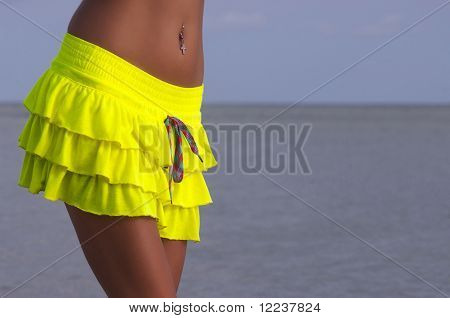 sexy tanned torso in yellow skirt